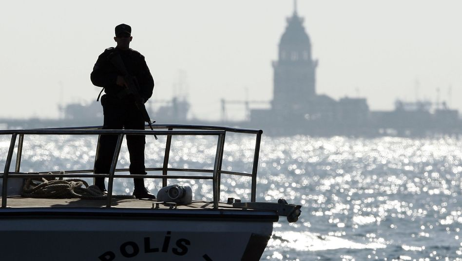 A Turkish policeman stands guard on a boat in the Bosphorus during the Organization of the Islamic Conference summit in Istanbul.