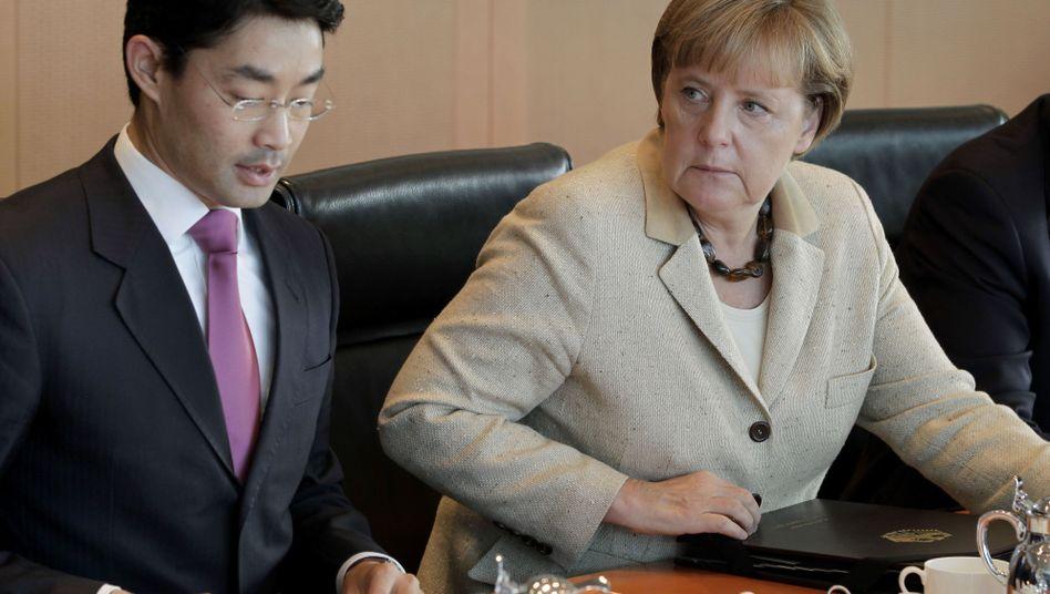 """Kanzlerin Merkel, Vizekanzler Rösler: """"Nervosität ist kein guter Ratgeber"""""""