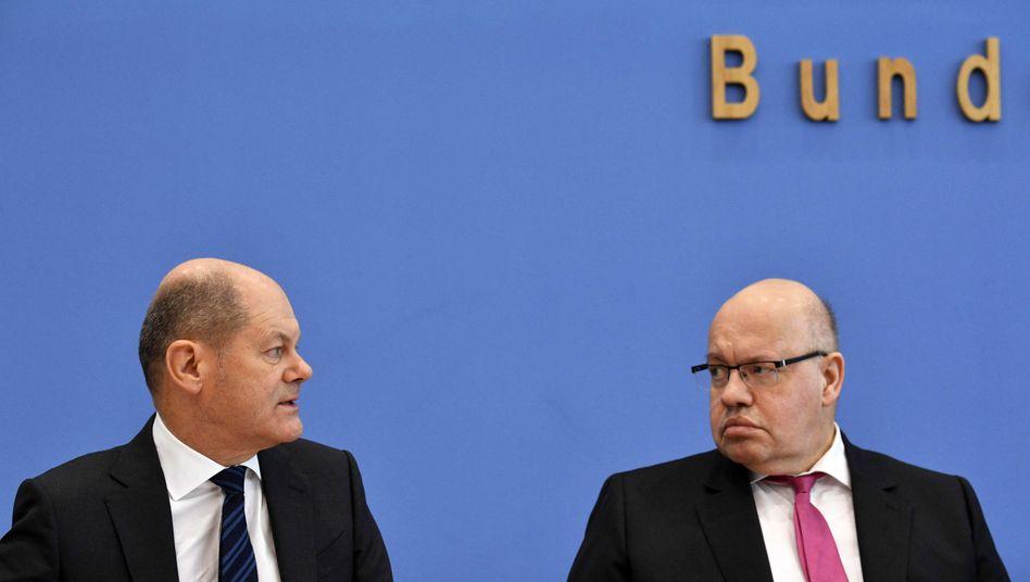 Finanzminister Olaf Scholz und Wirtschaftsminister Peter Altmaier Hilfe für die Unternehmen