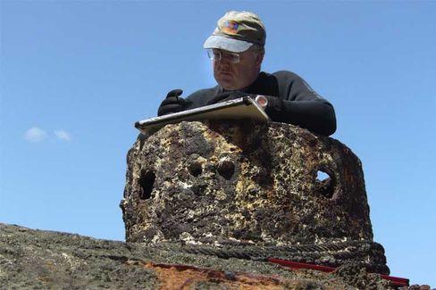 "Jim Delgado in the tower of the ""Explorer."""