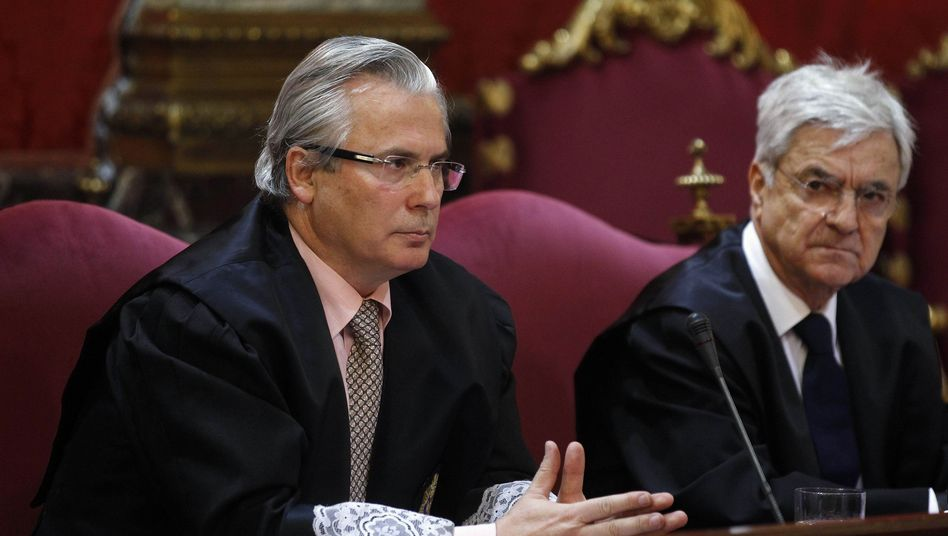 Baltasar Garzón (left) sits with his lawyer at the start of his Supreme Court trial in Madrid.