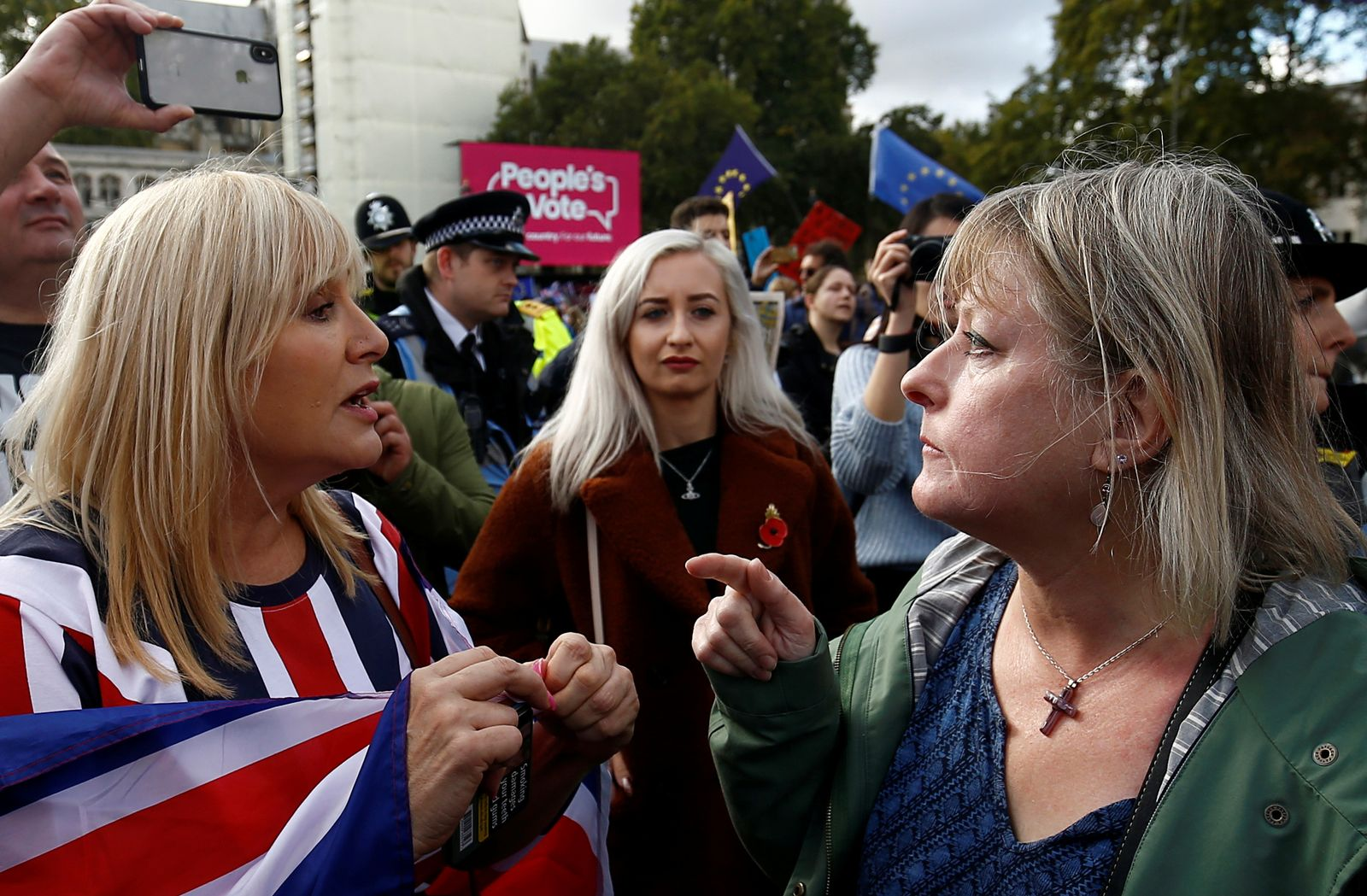 Pro-Brexit and anti-Brexit demonstrators argue at the Parliament Square as parliament sits on a Saturday for the first time since the 1982 Falklands War, to discuss Brexit in London