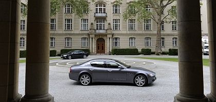 Sergio Marchionne's Maserati Quattroporte waits outside the Economy Ministry in Berlin Monday: Can the Fiat CEO pull off a three-way merger with Chrysler and Opel?