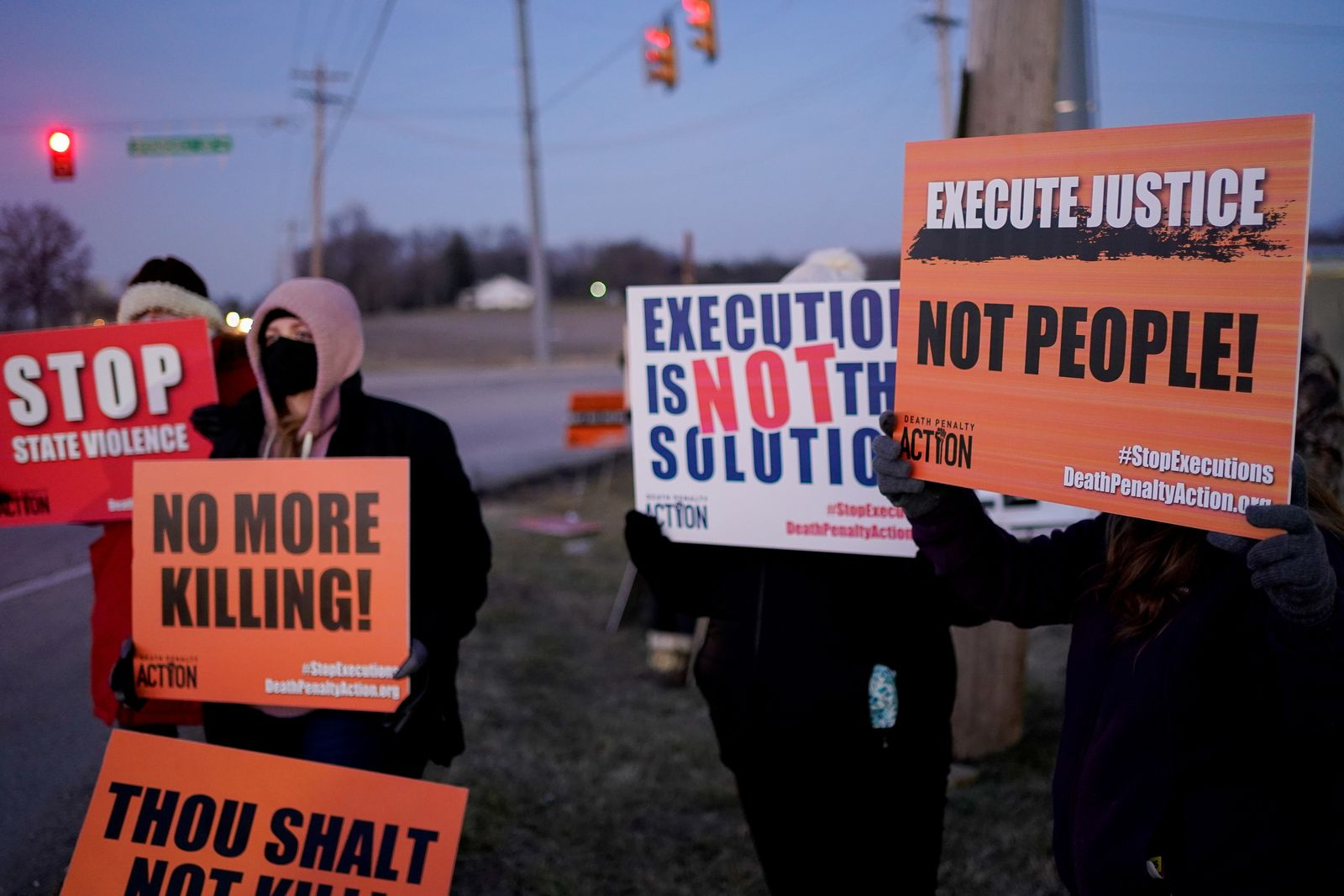 Activists in opposition to the death penalty gather to protest the execution of Lisa Montgomery