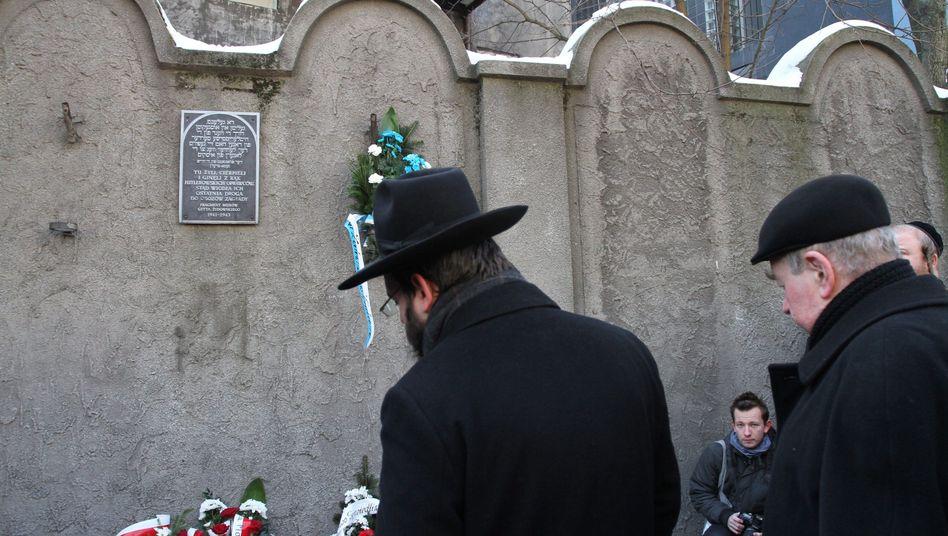 A rabbi prays in a former Jewish ghetto in Krakow, Poland, on March 17, 2013.