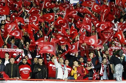 Supporters of the Turkish national soccer team wave the national flag before their Euro 2008 qualifying soccer match against Greece in Istanbul last October.