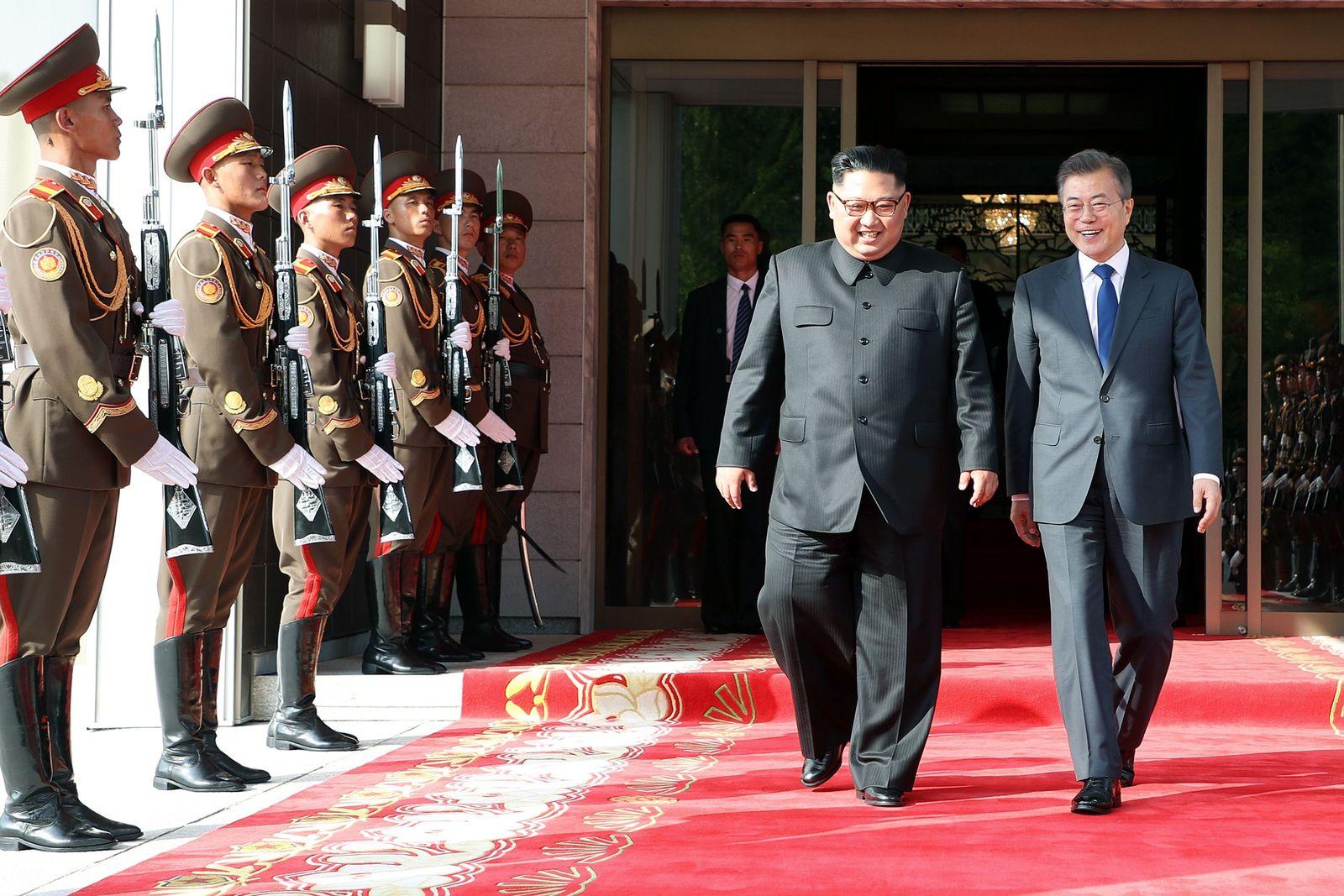 Moon Jae-in/ Kim Jong Un