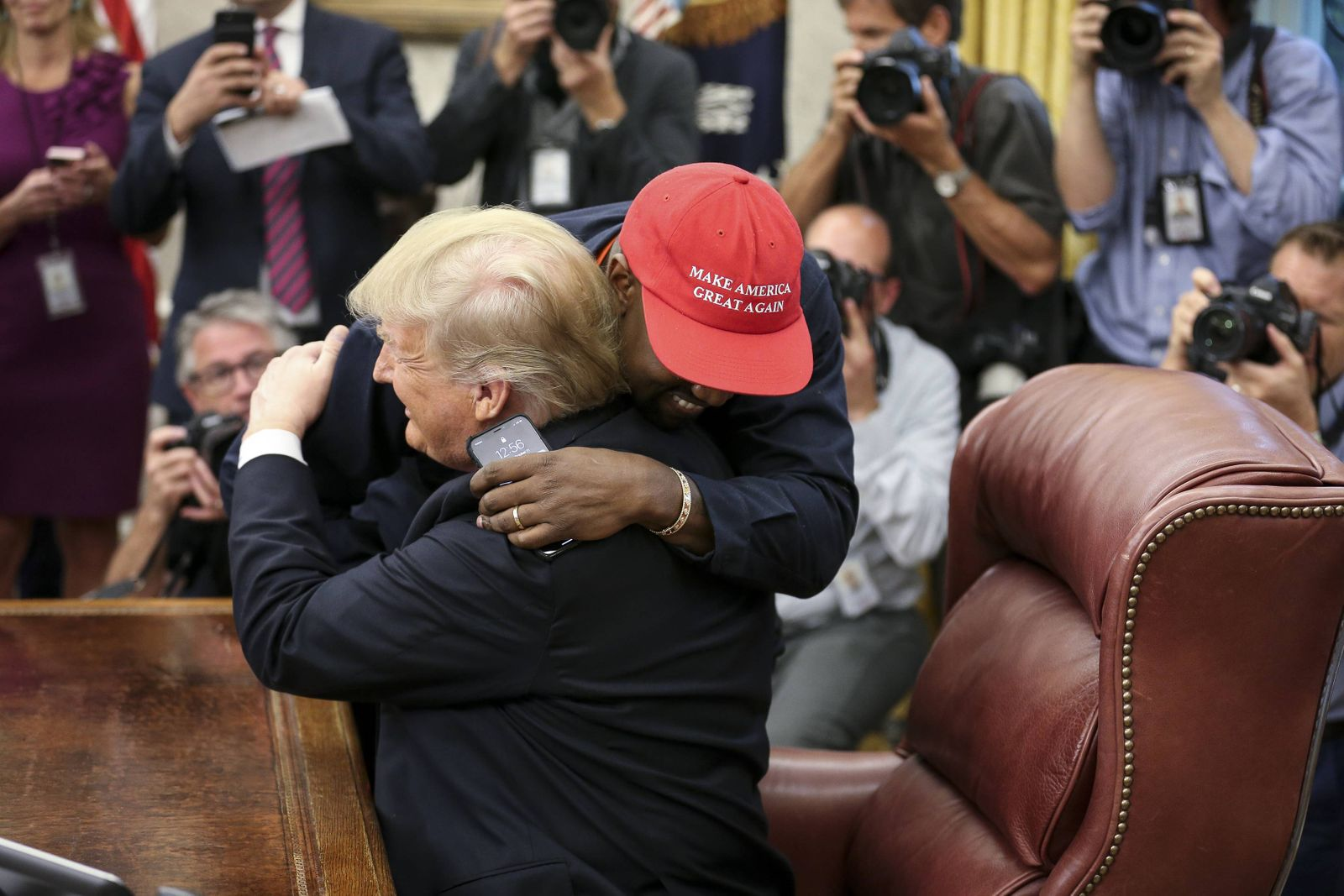 President Donald Trump hugs Kanye West during a meeting in the Oval office of the White House on Oct