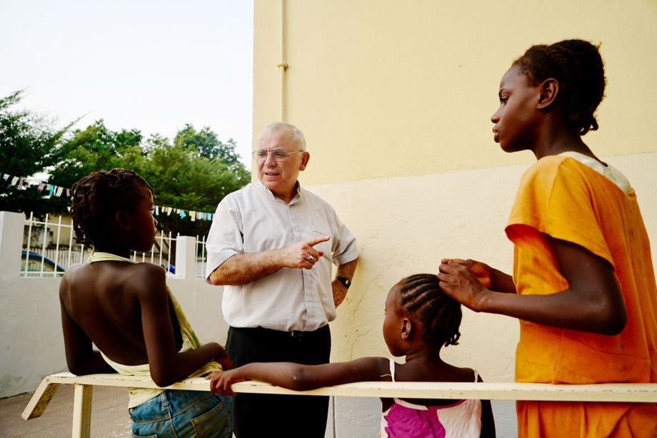 Bishop Manuel dos Santos talks to children from his parish. Like many others, he's worried about São Tomé and Príncipe's reputation.