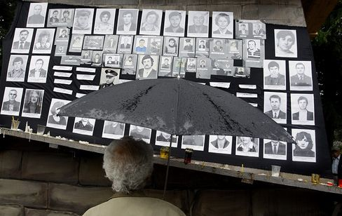 An Ossetian man views portraits of people killed in the Aug. 2008 Russia-Georgia war at the Genocide Museum in Tskhinvali.