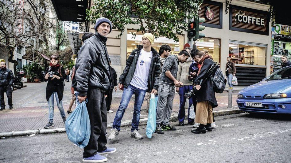 Freigelassene Migranten in Athen Risse in der Regierungskoalition