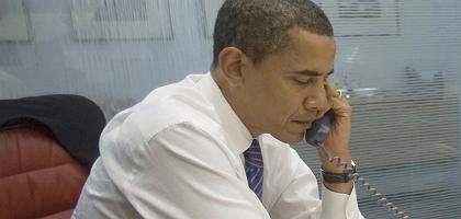 US President-elect Barack Obama speaks on the phone in a Chicago office to world leaders.