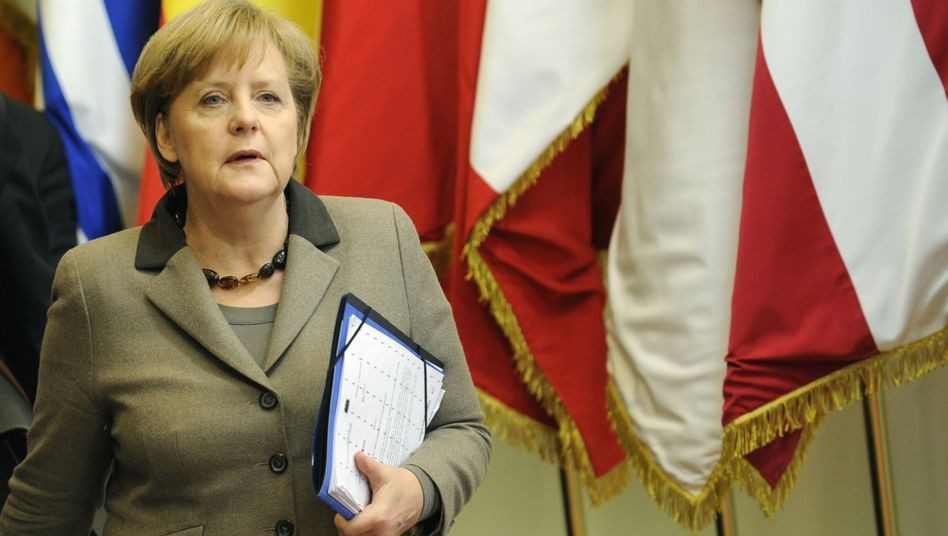 German Chancellor Angela Merkel leaves the euro-zone summit on Saturday morning.