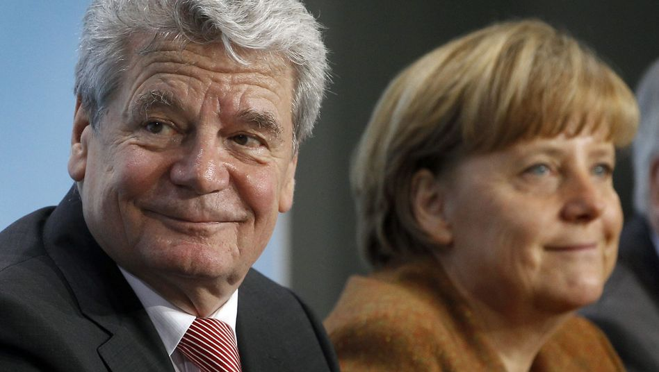 German Chancellor Angela Merkel and Joachim Gauck at Sunday evening's press conference at the Chancellery in Berlin.
