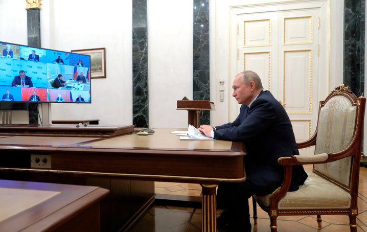 President Putin leads a video conference from an office in his home.
