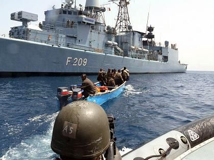 """Pirates being arrested by soldiers from the German navy frigate """"Rheinland Pfalz"""" in the Gulf of Aden in March."""