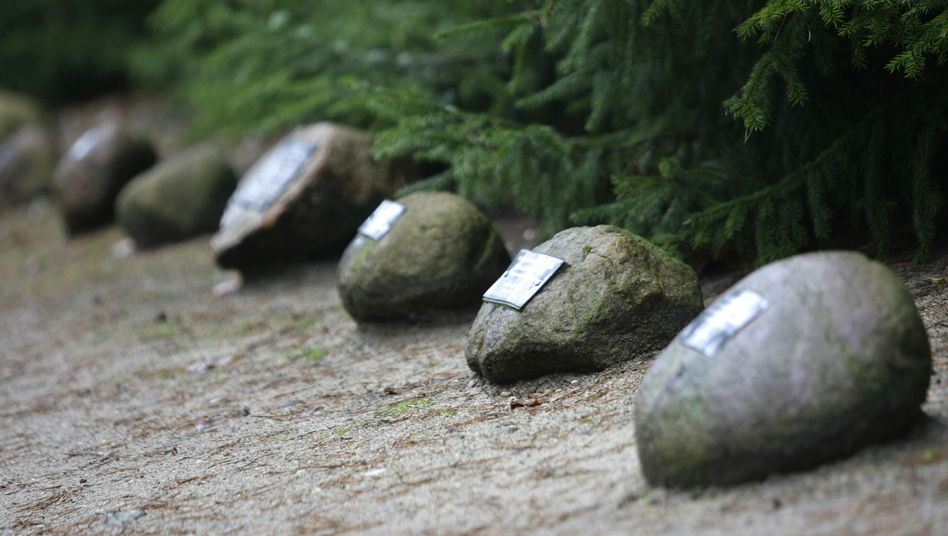 Stones with plaques commemorating people killed at Sobibor death camp.