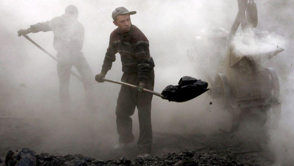 Arbeiter in der chinesischen Kohlemine Yaojie