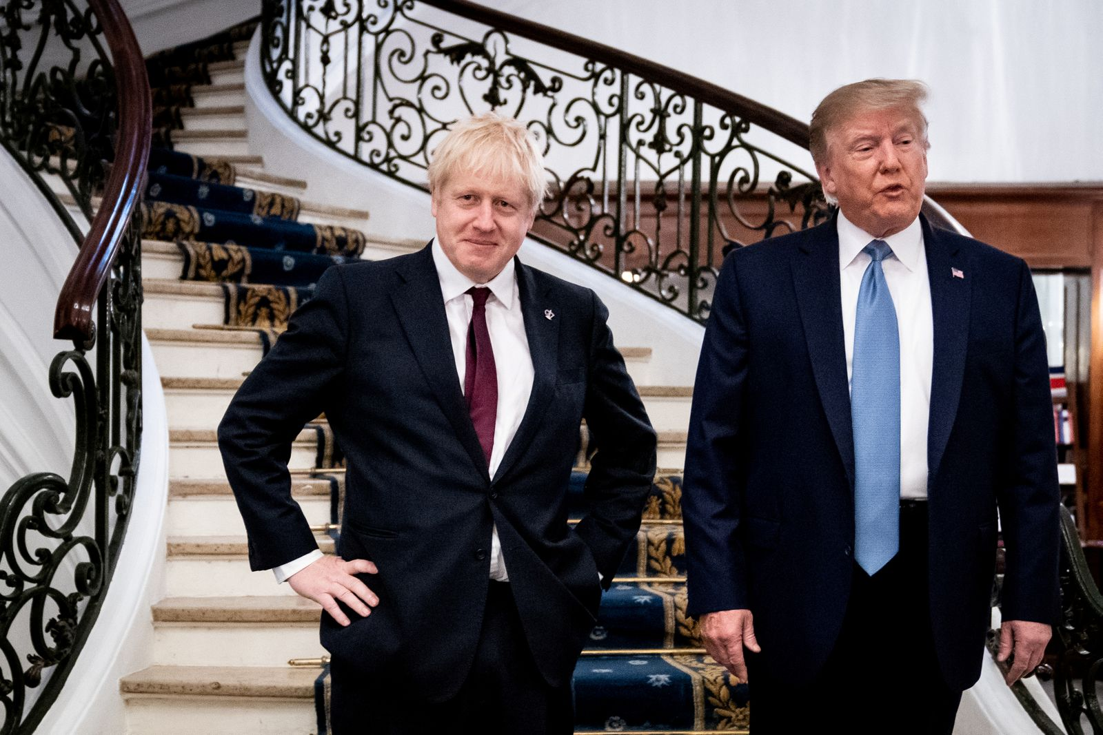 FILE PHOTO: U.S. President Donald Trump and Britain's Prime Minister Boris Johnson arrive for a bilateral meeting during the G7 summit in Biarritz, France