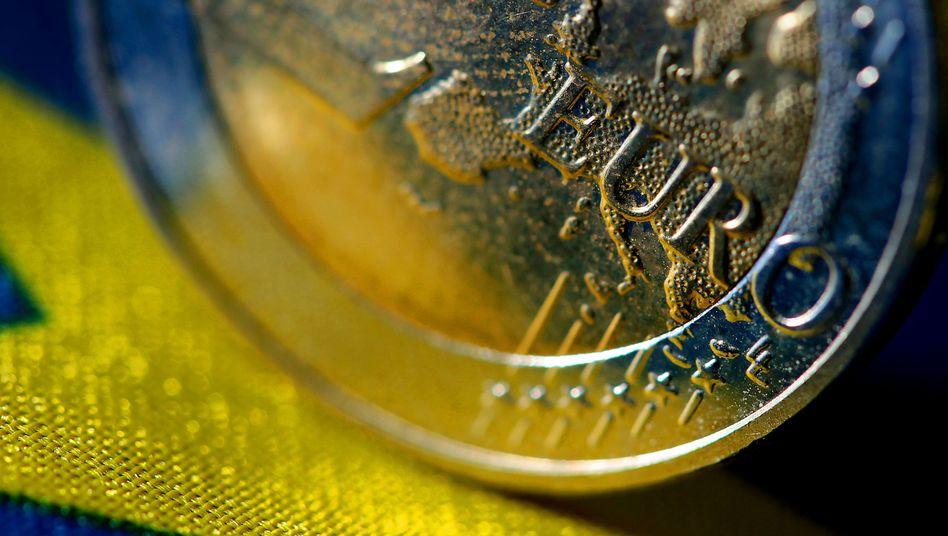 Euro-Münze: Gefahr für die Vorherrschaft des Dollars?