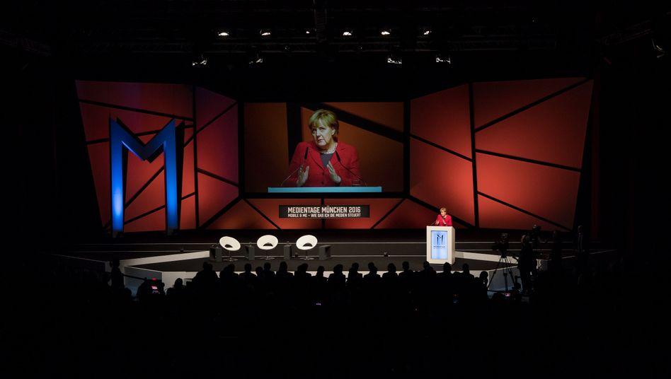 German Chancellor Angela Merkel speaking to media professionals in Munich