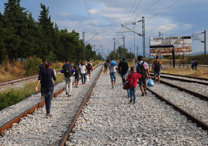 Entire families are making their way along the train tracks from Greece to Macedonia, an important stop on the route to Western Europe.