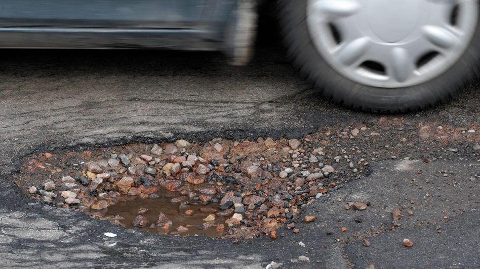 A German village wants to patch its streets with money made from selling potholes.