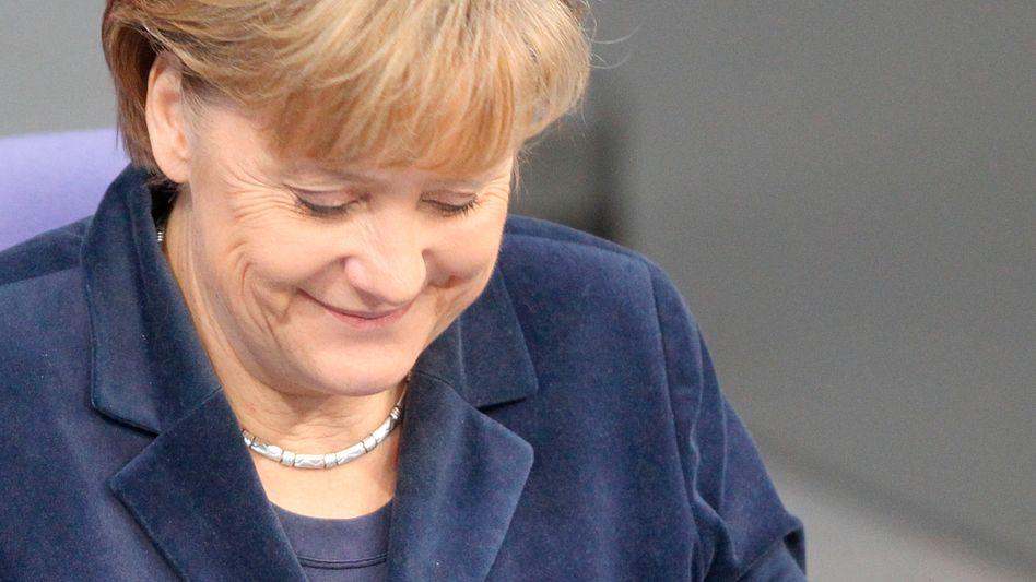 Kanzlerin Angela Merkel (CDU) mit iPad: Gefangene der neuen Medien?