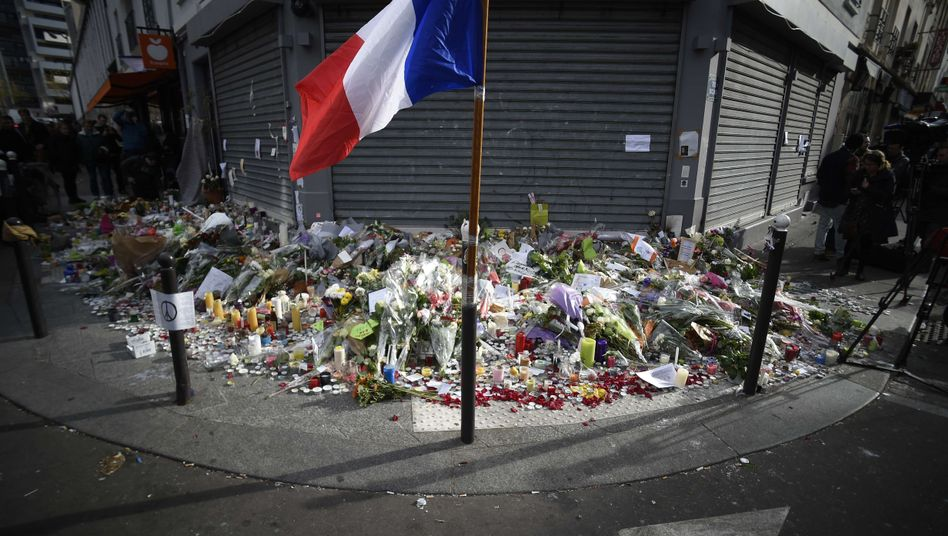 A makeshift memorial set up in front of the Parisian restaurant Le petit Cambodge, one of the sites in the Nov. 13 terrorist attacks.