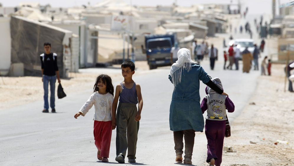 Photo Gallery: Two Million Flee Syria