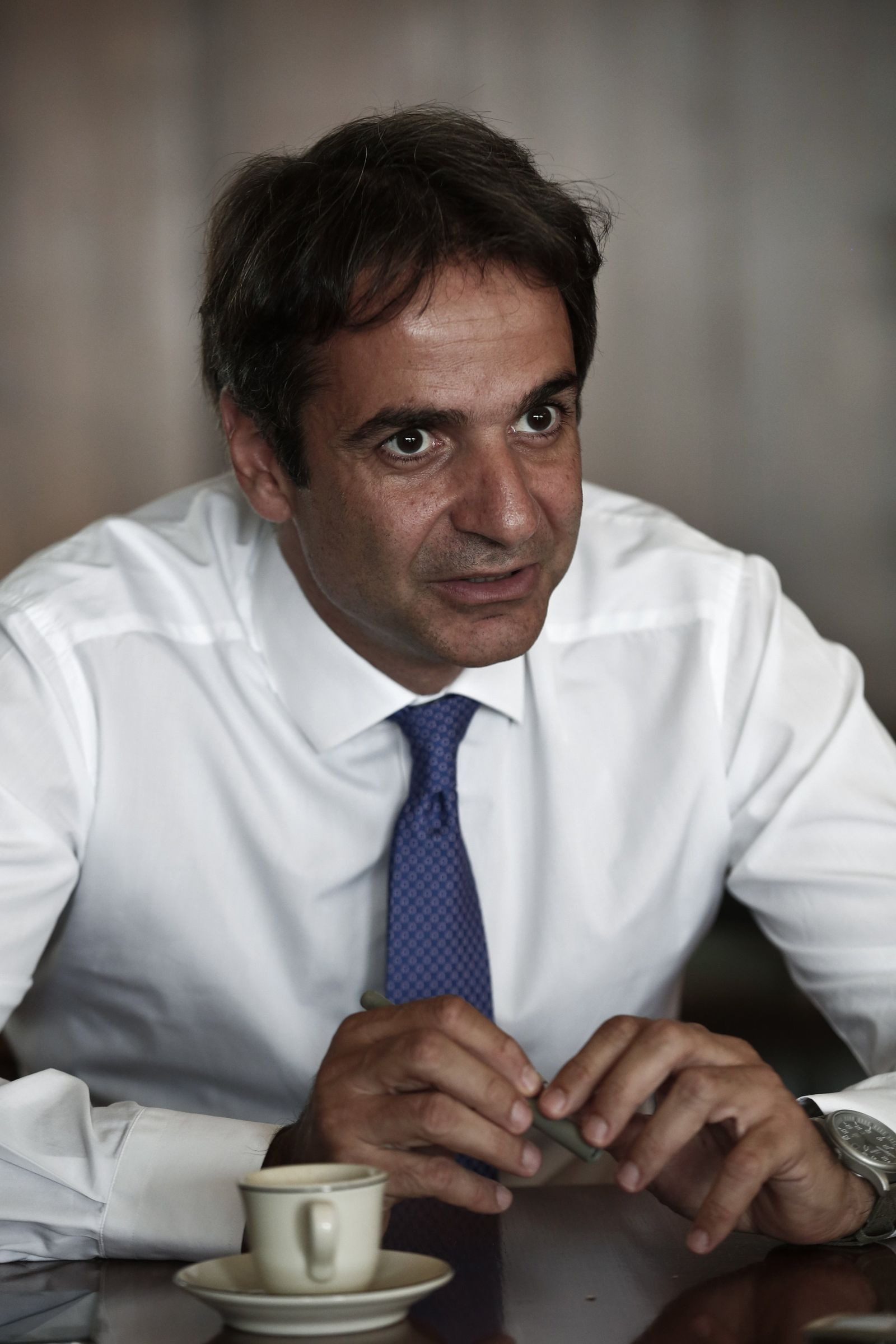 Greece's Administrative Reform minister Kyriakos Mitsotakis speaks during an interview with Reuters in Athens