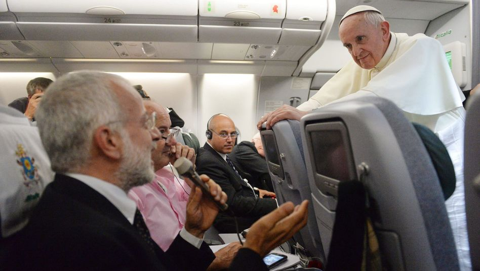 Pope Francis talks to journalists while flying home from his a week-long tour of Brazil, which culminated at the Catholic World Youth festival on Rio de Janeiro's Copacabana beach.