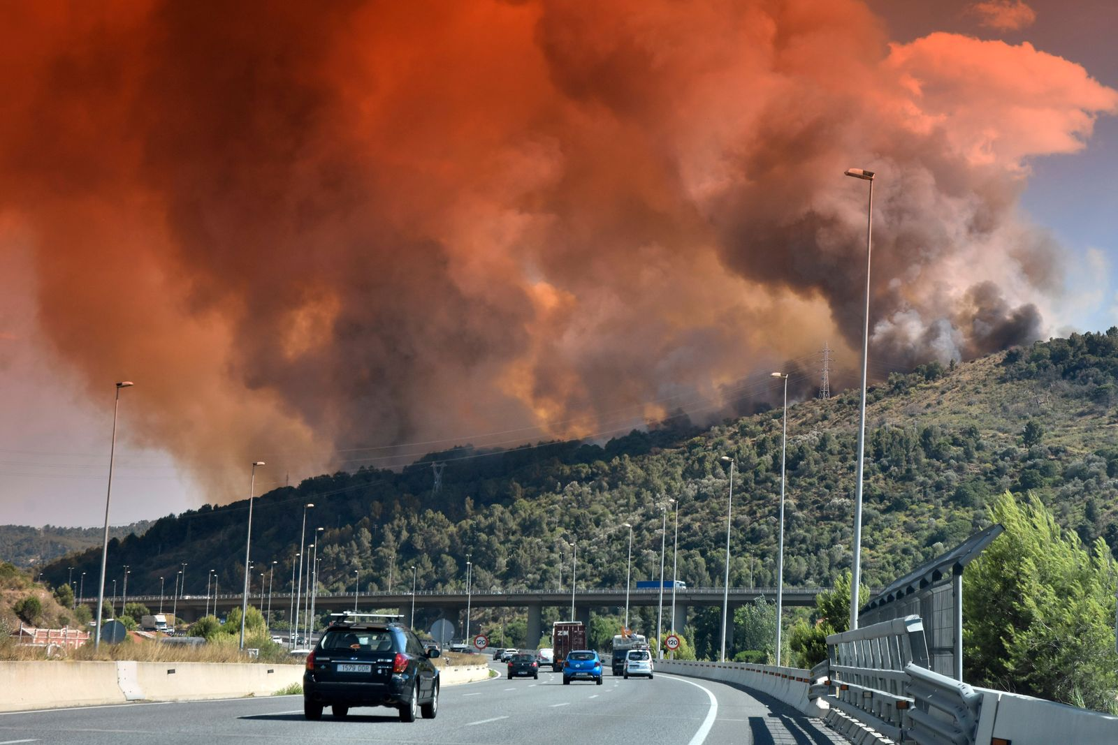 A cloud of smoke and fire in Castellvi de Rosanes seen over