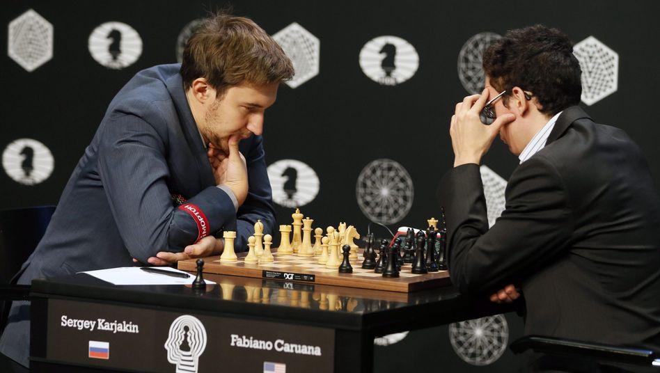 Sergej Karjakin (l), Fabiano Caruana