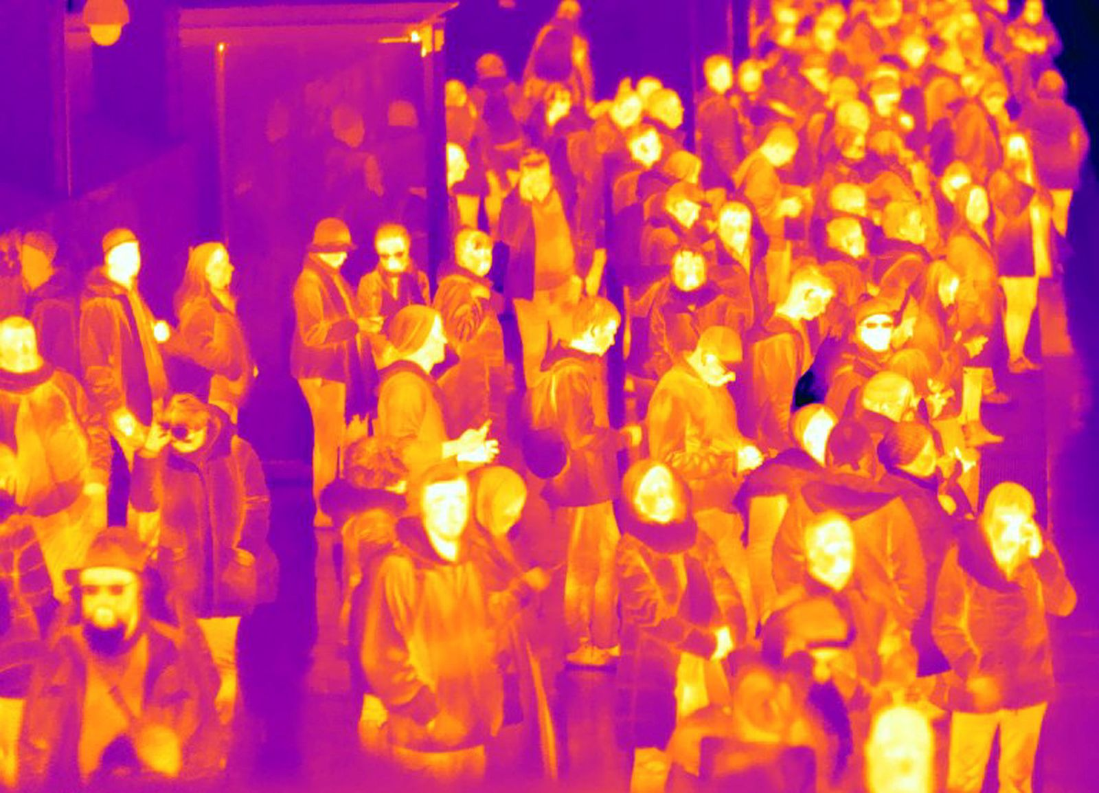 Commuters waiting for an U-Bahn underground train taken with thermal imaging camera in Berlin