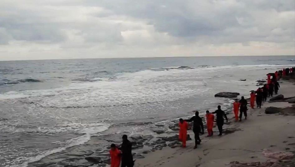 A video grab shows militants loyal to the Islamic State marching Egyptian Coptic Christians to their deaths by beheading in Libya.