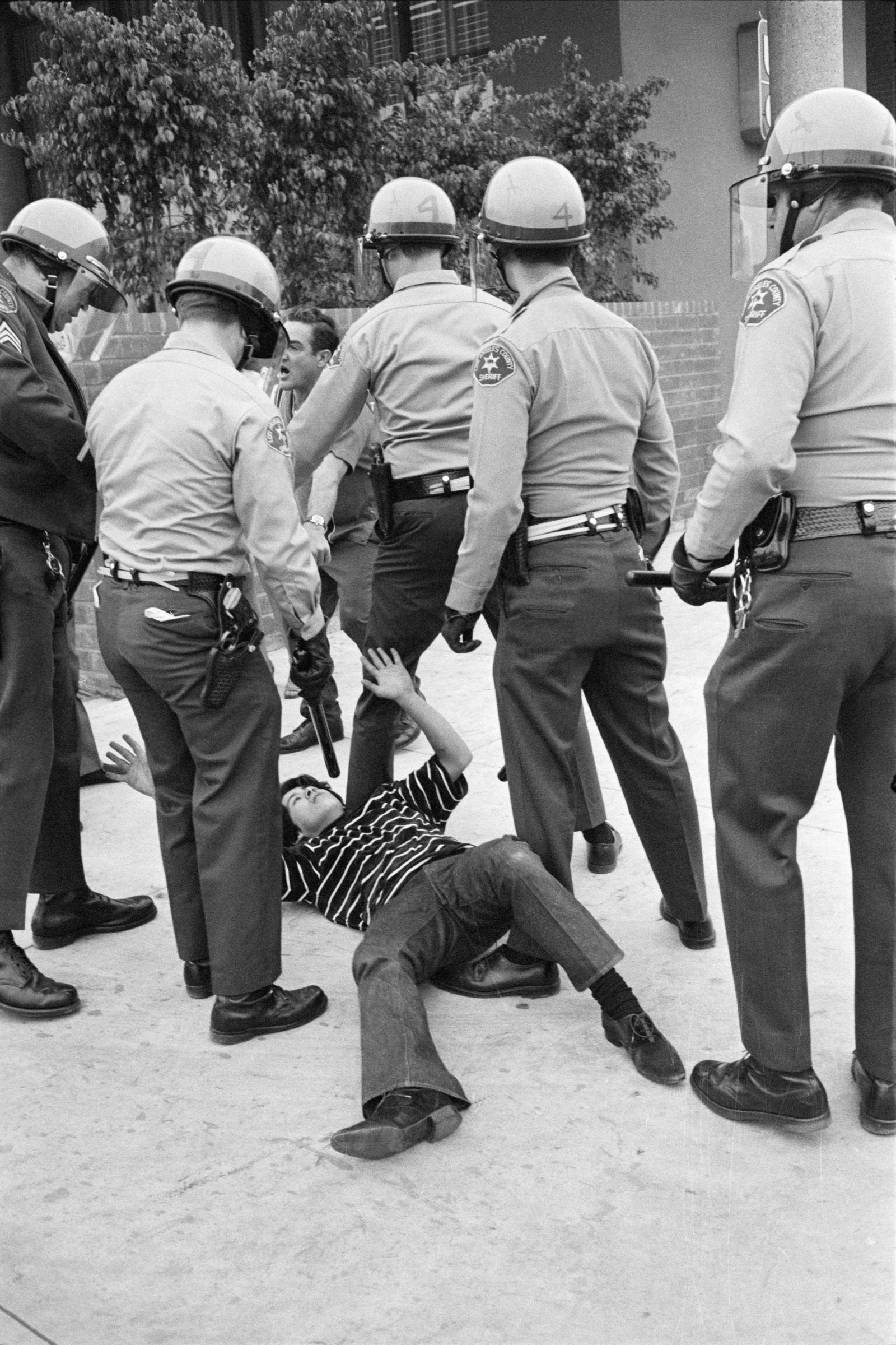 Police Subdue Young Latino Protester