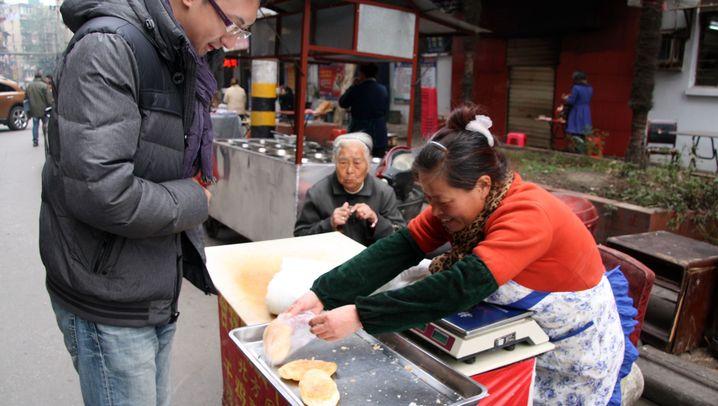 Streetfood in Peking und Wuhan: Etwas Puffreis für zwischendurch?