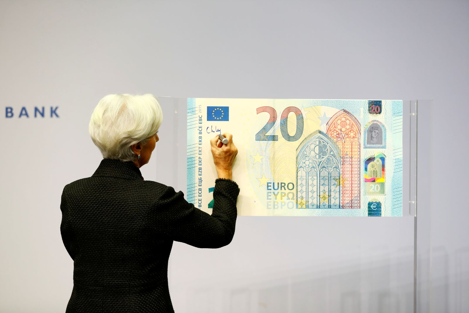 FILE PHOTO: FILE PHOTO: European Central Bank (ECB) President Lagarde gives a signature for newly printed euro banknotes in Frankfurt