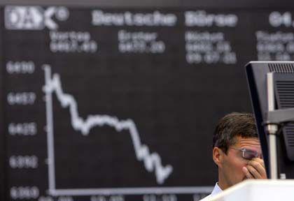 Börsianer in Frankfurt: Trübe Aussichten belasten den Dax
