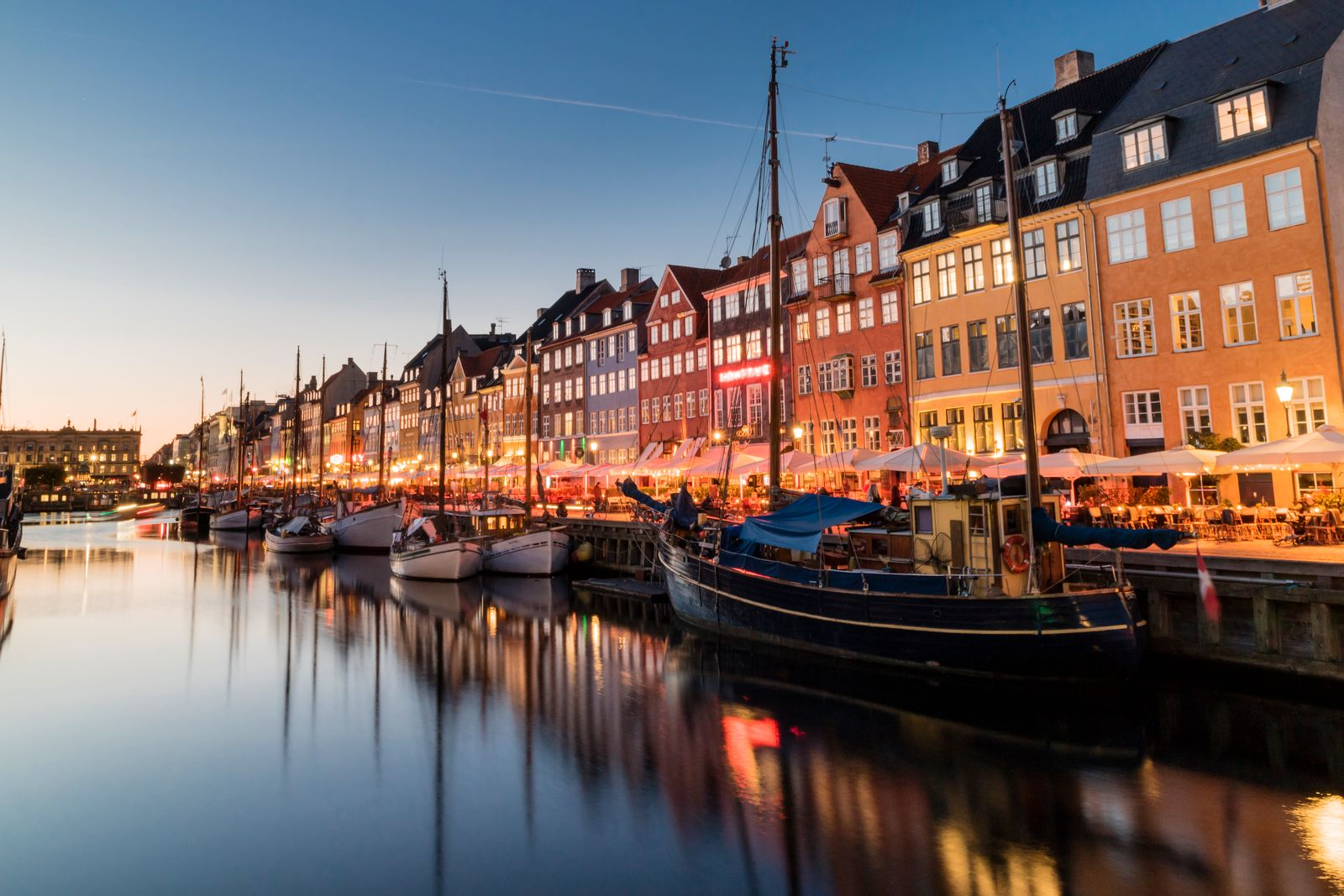 Nyhavn water front canal and touristic street at night