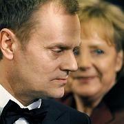 "Polish Prime Minister Donald Tusk (front) and German Chancellor Angela Merkel: ""I am not stirring up emotions."""