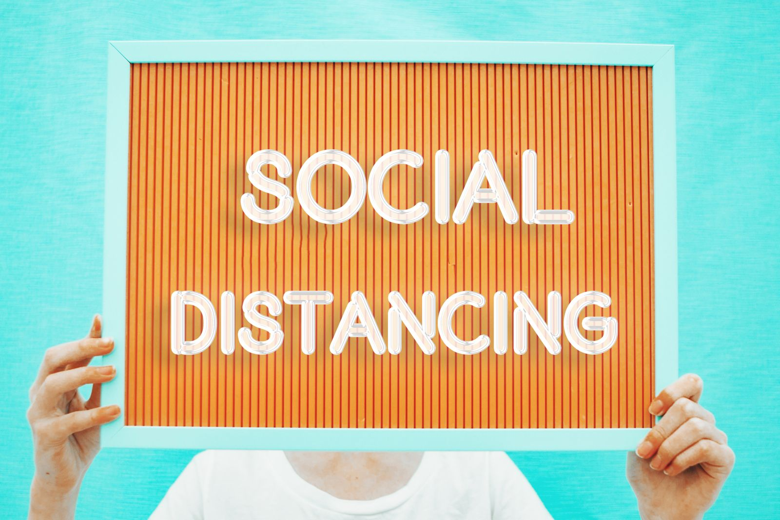 "male boy holding "" social distancing"" text"