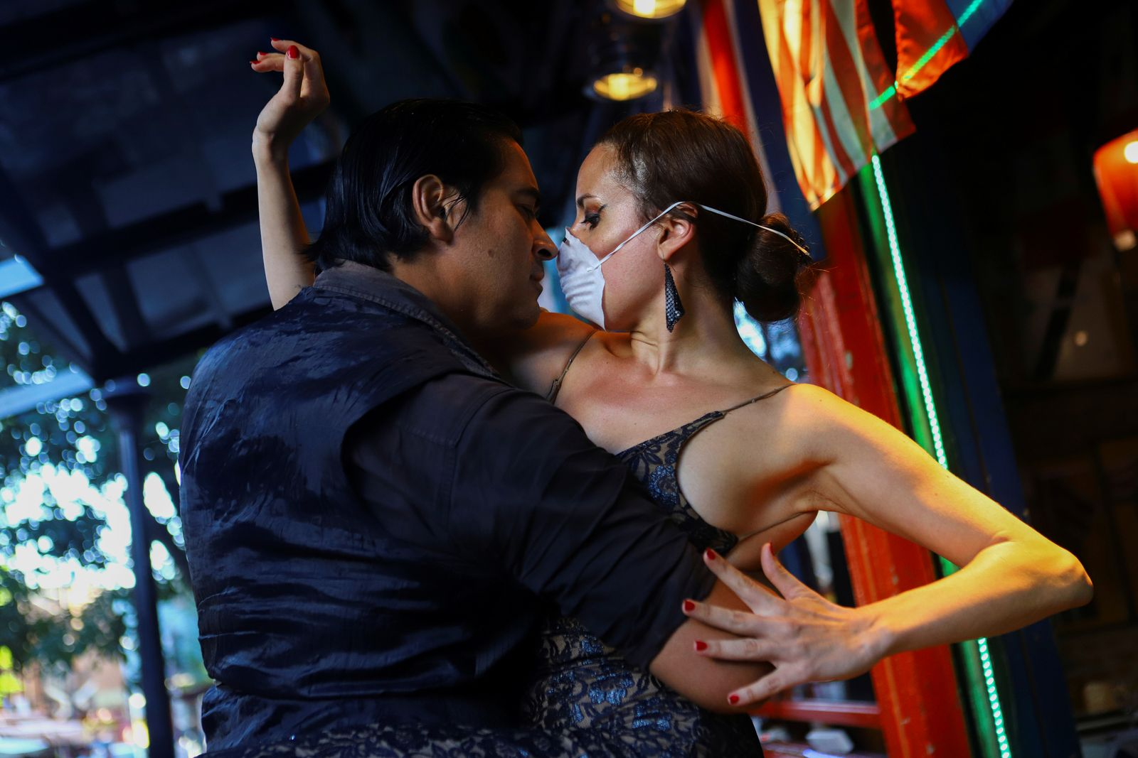"Makrina Anastasiadou and her tango partner ""El Morocho"" dance for the public at an almost empty restaurant after tango shows have been suspended to prevent the spread of coronavirus (COVID-19), in Buenos Aires"