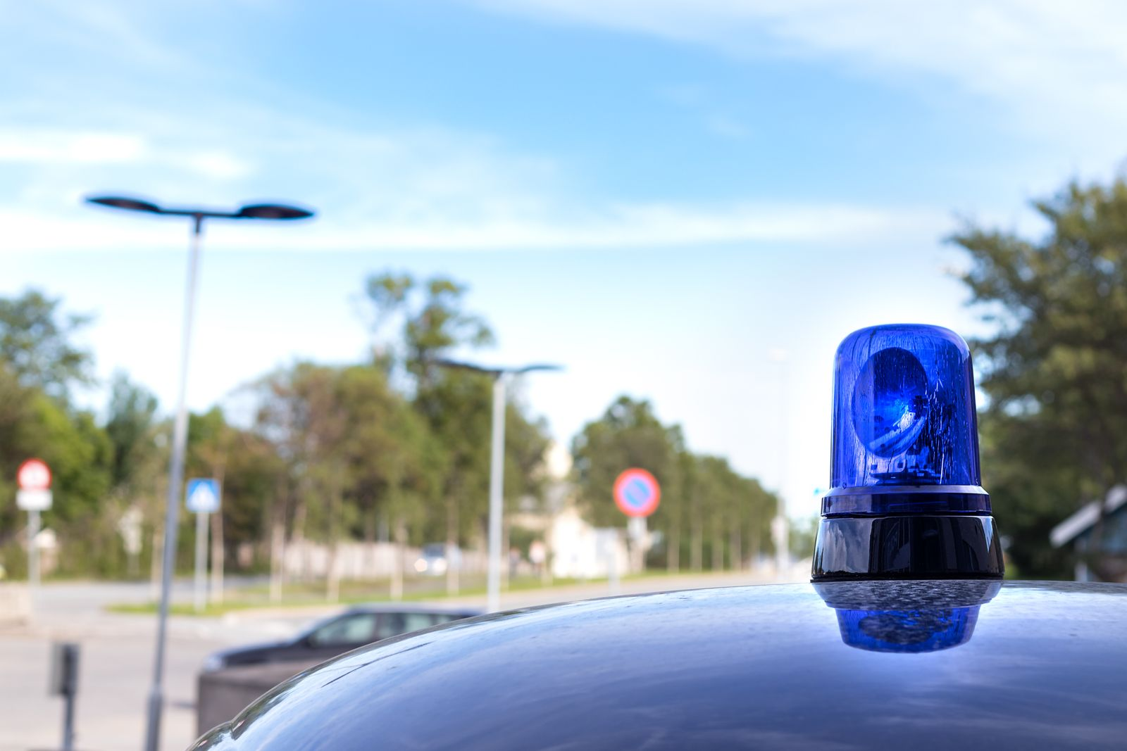Closeup of vintage blue roof light siren of a police car in Norway.
