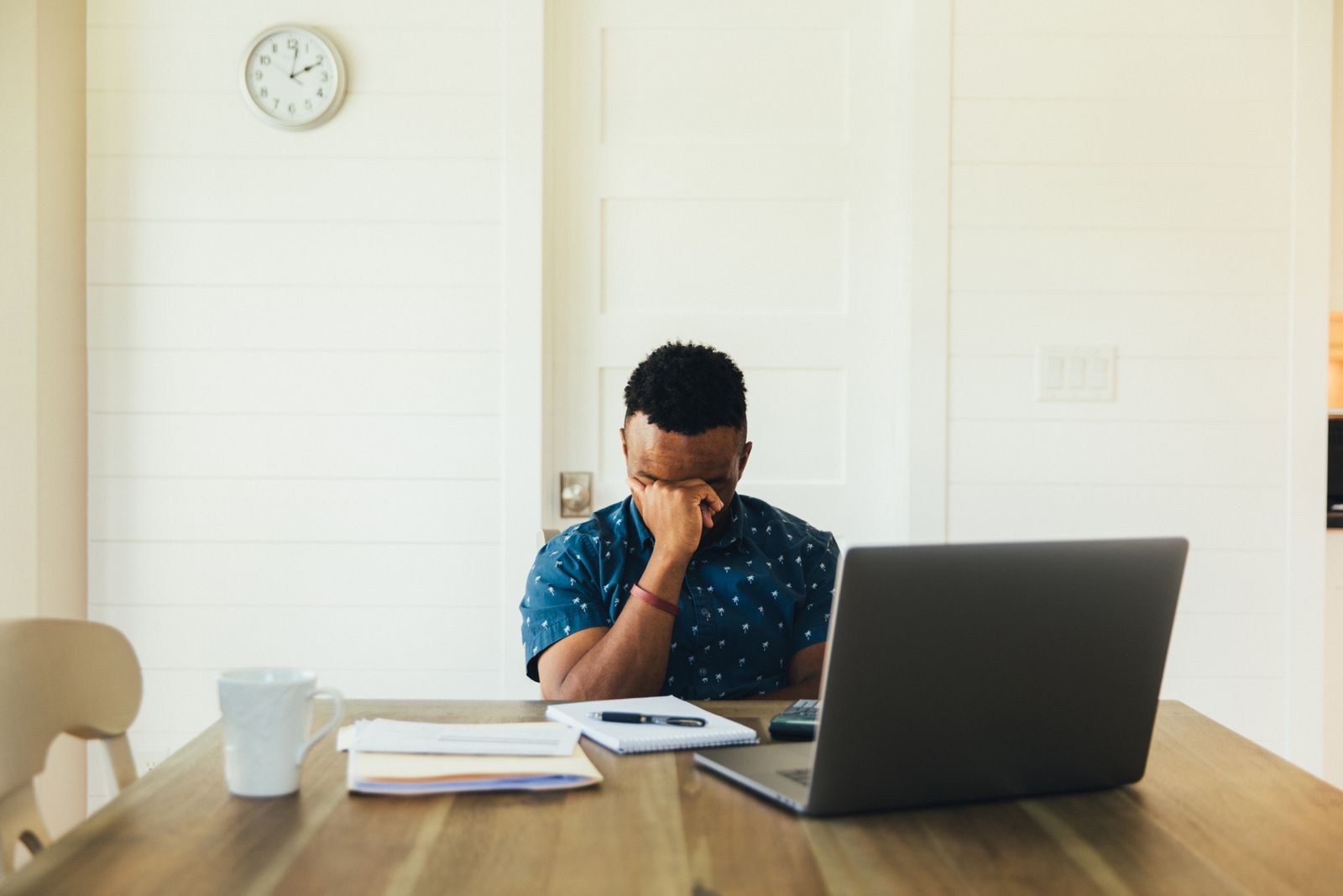 Worried Man Doing Finances at Home