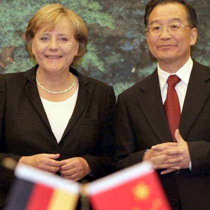 All smiles: German Chancellor Angela Merkel and Chinese Premier Wen Jiabao during a news conference on Monday.