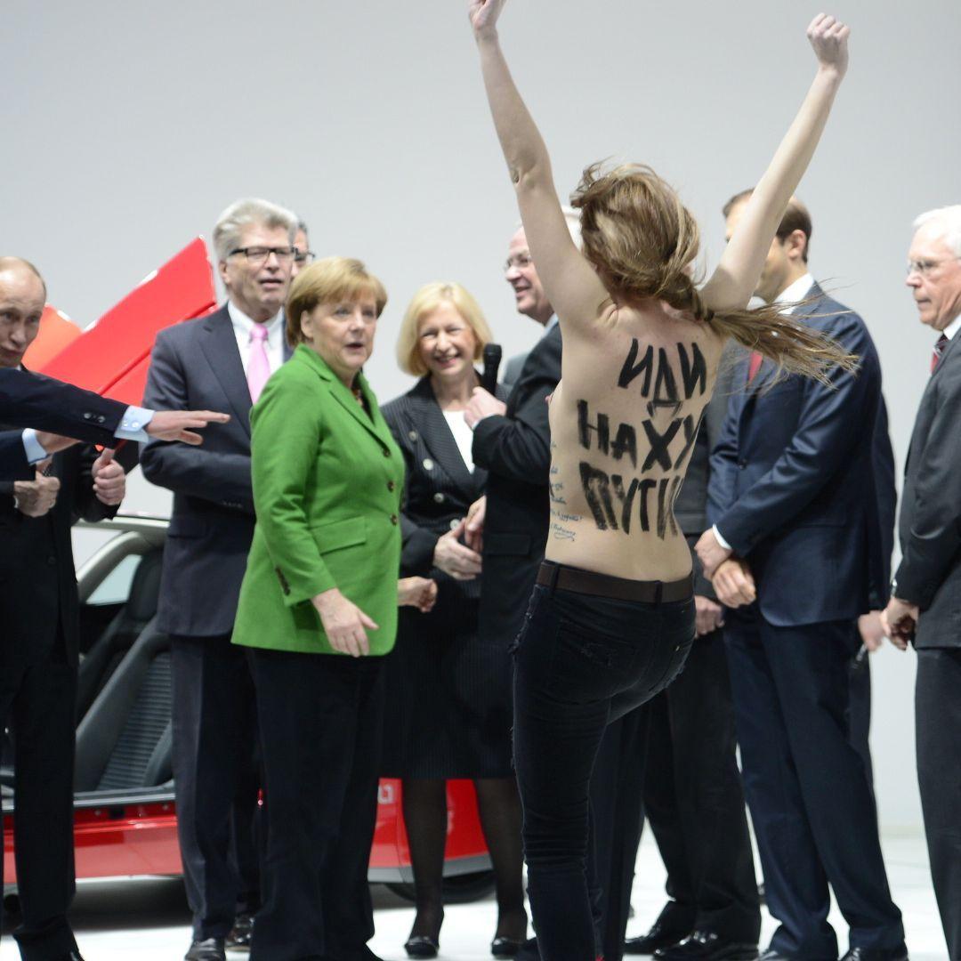 Angela Merkel Nude putin visibly amusedtopless femen protest in germany