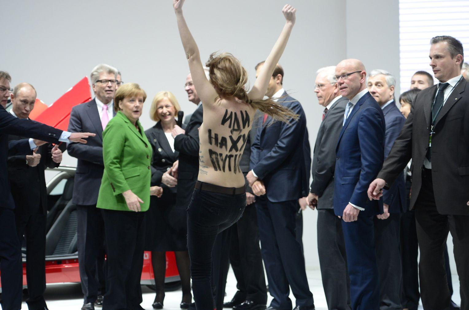Angela Merkel Topless putin visibly amusedtopless femen protest in germany
