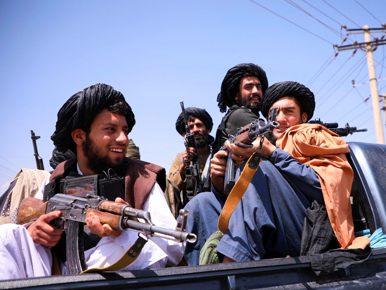 Taliban forces patrol in front of Hamid Karzai International Airport in Kabul